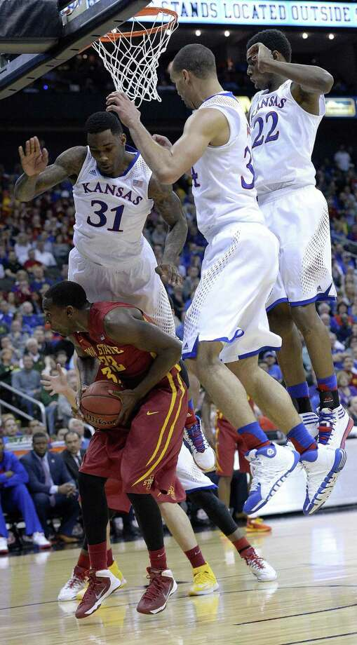 Iowa State's Dustin Hogue is fouled by Kansas' Jamari Traylor (left) as Perry Ellis (middle) and Andrew Wiggins try to defend during their Big 12 semifinal. Photo: John Sleezer / McClatchy-Tribune News Service / Kansas City Star