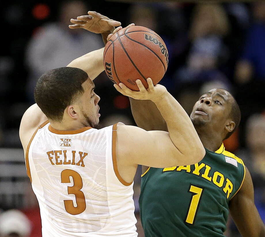 Baylor's Kenny Chery (right) tries to block Texas' Javan Felix. Chery scored 10 points; Felix just two. Photo: Charlie Riedel / Associated Press / AP