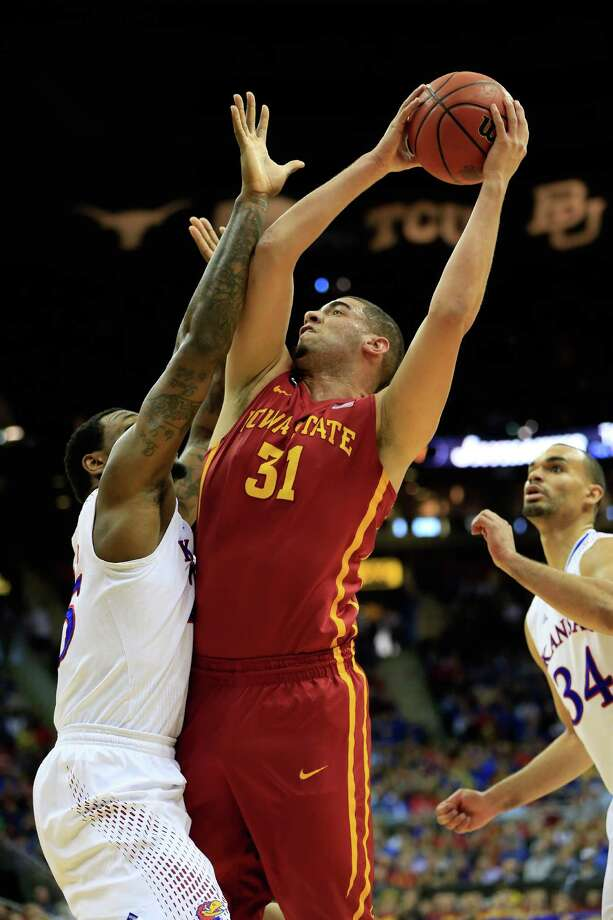 KANSAS CITY, MO - MARCH 14:  Georges Niang #31 of the Iowa State Cyclones shoots over Tarik Black #25 of the Kansas Jayhawks during the Big 12 Basketball Tournament semifinal game at Sprint Center on March 14, 2014 in Kansas City, Missouri.  (Photo by Jamie Squire/Getty Images) ORG XMIT: 476097085 Photo: Jamie Squire / 2014 Getty Images