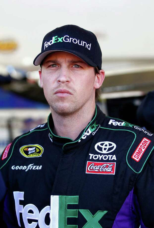 LAS VEGAS, NV - MARCH 07:  Denny Hamlin, driver of the #11 FedEx Ground Toyota, stands in the garage area during practice for the NASCAR Sprint Cup Series Kobalt 400 at Las Vegas Motor Speedway on March 7, 2014 in Las Vegas, Nevada.  (Photo by Jonathan Ferrey/Getty Images) Photo: Jonathan Ferrey, Stringer / 2014 Getty Images