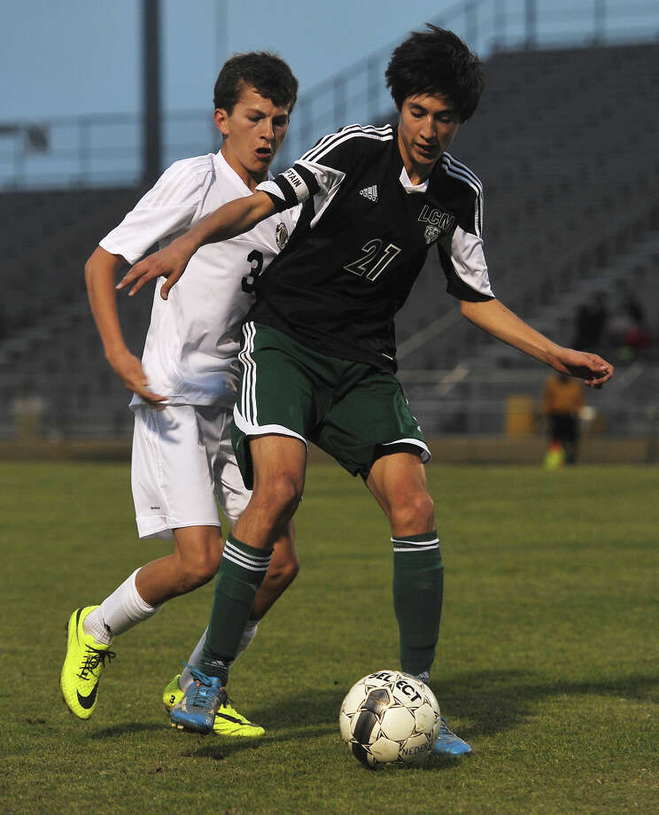 Little Cypress-Mauriceville's Cesar Coca, No. 21, keeps Nederland's Ryan Roebuck, No. 3, from the ball during Friday's match. The Little Cypress-Mauriceville soccer team played against Nederland at Nederland on Friday. Photo taken Friday, 3/14/14 Jake Daniels/@JakeD_in_SETX Photo: Jake Daniels / ©2014 The Beaumont Enterprise/Jake Daniels