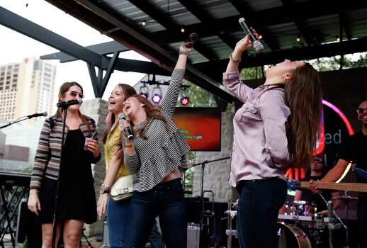 AUSTIN, TX - MARCH 14:  Consumers participate in Jam Band Karaoke at The Samsung Galaxy Experience at SXSW 2014 on March 14, 2014 in Austin, Texas. Photo: Rick Kern, Getty Images For Samsung / 2014 Getty Images