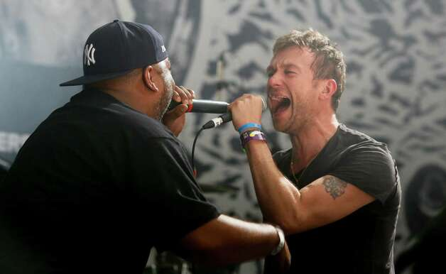 Damon Albarn, right, is joined by De La Soul's Vincent Mason while performing during the SXSW Music Festival Friday March 14, 2014, in Austin, Texas. (Photo by Jack Plunkett/Invision/AP) Photo: Jack Plunkett, Associated Press / Invision