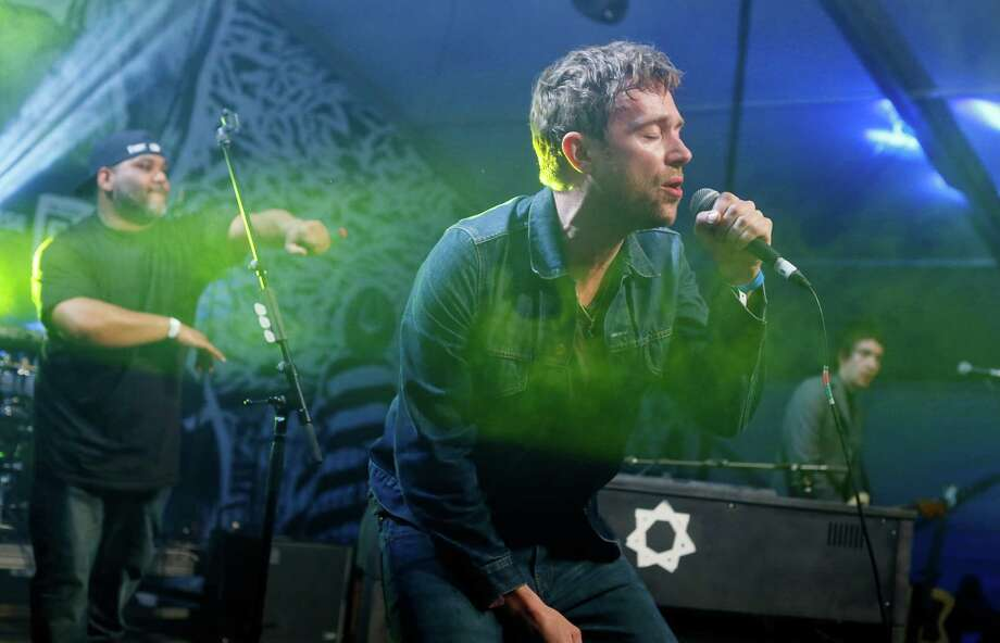 Damon Albarn, right, joined by De La Soul's Vincent Mason, left, performs during the SXSW Music Festival Friday March 14, 2014, in Austin, Texas. (Photo by Jack Plunkett/Invision/AP) Photo: Jack Plunkett, Associated Press / Invision