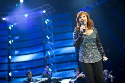 Reba McEntire, March 6    Reba McEntire strutted across the stage in a sparkly silver top  and black boots at the Houston Livestock Show and Rodeo. Photo: Marie D. De Jesús/Houston Chronicle