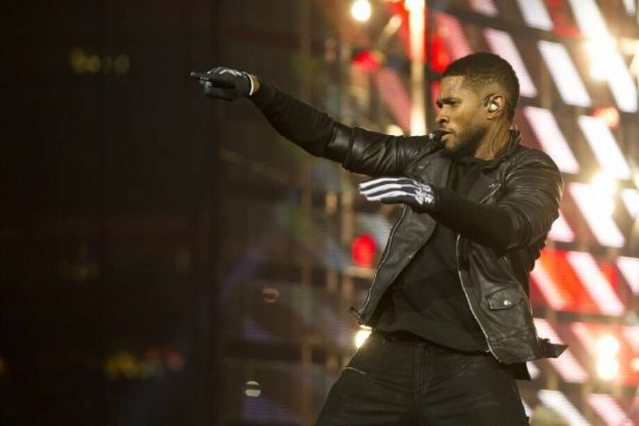 Usher, March 7 Usher filled his hour-long set with overtly sexual dance moves and flashes of his six-pack abs  at the Houston Livestock Show and Rodeo. Photo: Marie D. De Jesús/Houston Chronicle