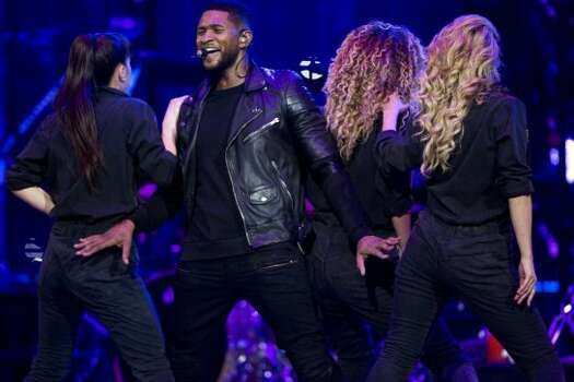 Usher, March 7    R&B and pop heartthrob Usher performed  at the Houston Livestock Show and Rodeo. Photo: Marie D. De Jesús/Houston Chronicle