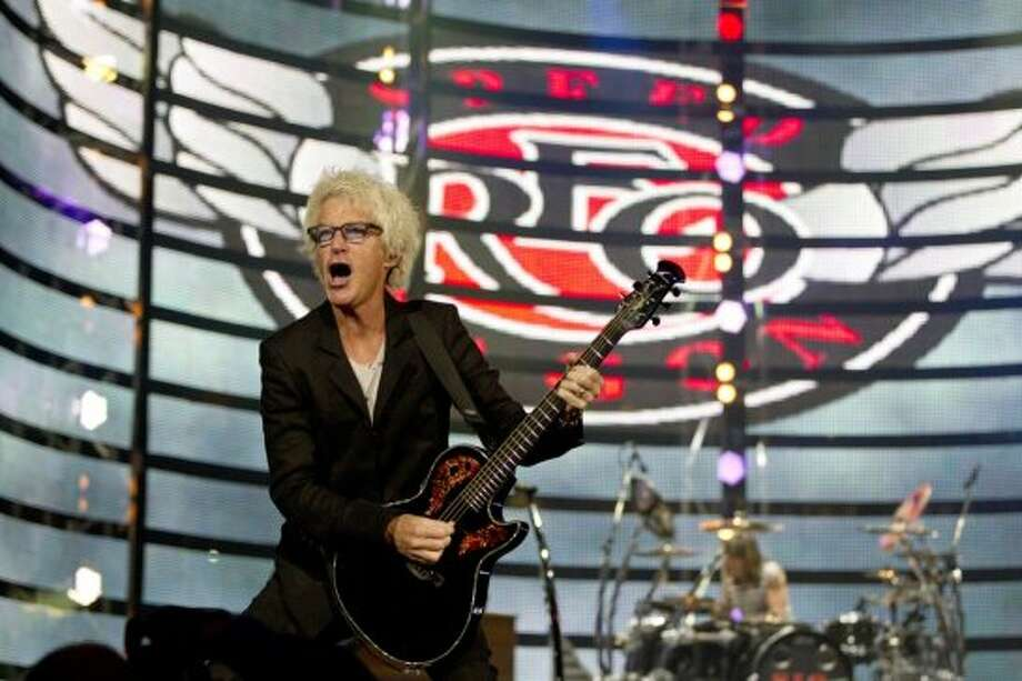REO Speedwagon, March 10    REO Speedwagon's performance inspired much of the crowd to lift their lighters and cellphones into the air  at the Houston Livestock Show and Rodeo. Photo: Johnny Hanson/Houston Chronicle
