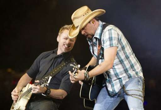 Jason Aldean, March 11    Jason Aldean brought a little bit of country and a little bit of rock 'n' roll to his fifth consecutive appearance at the Houston Livestock Show and Rodeo. Photo: Johnny Hanson/Houston Chronicle