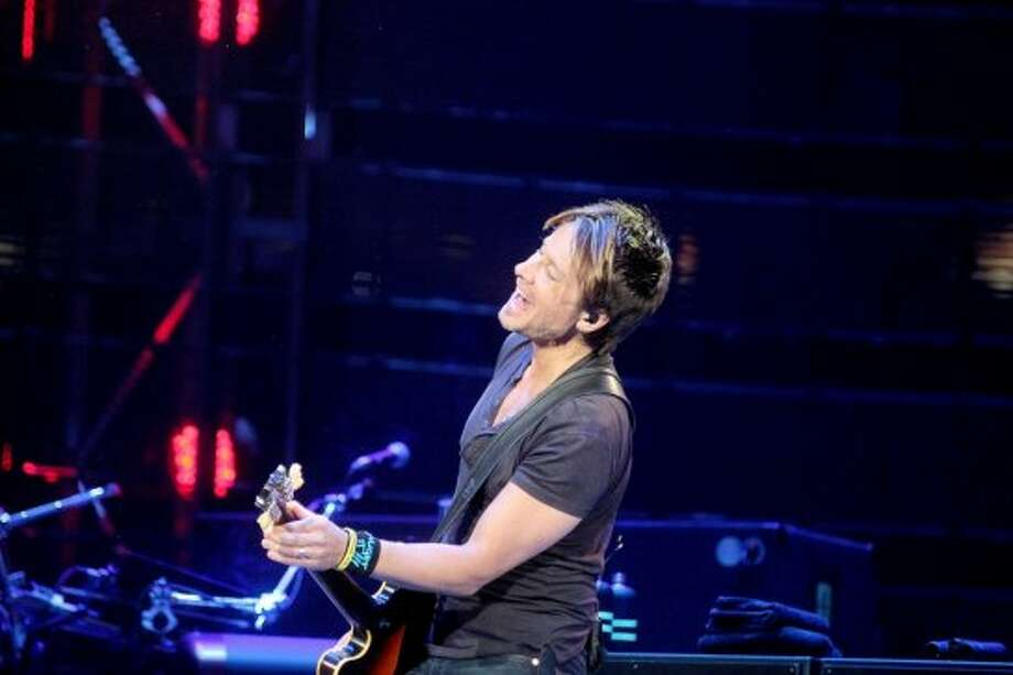 """Keith Urban, March 14""""We're back playing Houston again at the rodeo. The first time we played was in 2005, and I have the buckle to prove it,"""" Keith Urban said   at the Houston Livestock Show and Rodeo. Photo: Pin Lim/For The Chronicle"""
