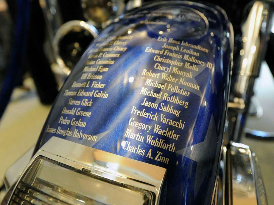 "The names of Greenwich residents who lost their lives in the 911 terrorist attacks are visible on the front fender of the ""Tribute to Heroes"" motorcycle during the unveiling of the motorcycle in a ceremony at Greenwich Police Headquarters in Greenwich, Conn., Saturday morning, March 15, 2014. According to Greenwich Police Sgt. John Slusarz, the Tribute motorcycle project was the collaboration of many officers within the department and  honors the heroes of the 911 terrorist attacks and the three Greenwich Police Officers who lost their lives in the line of duty. Photo: Bob Luckey / Greenwich Time"
