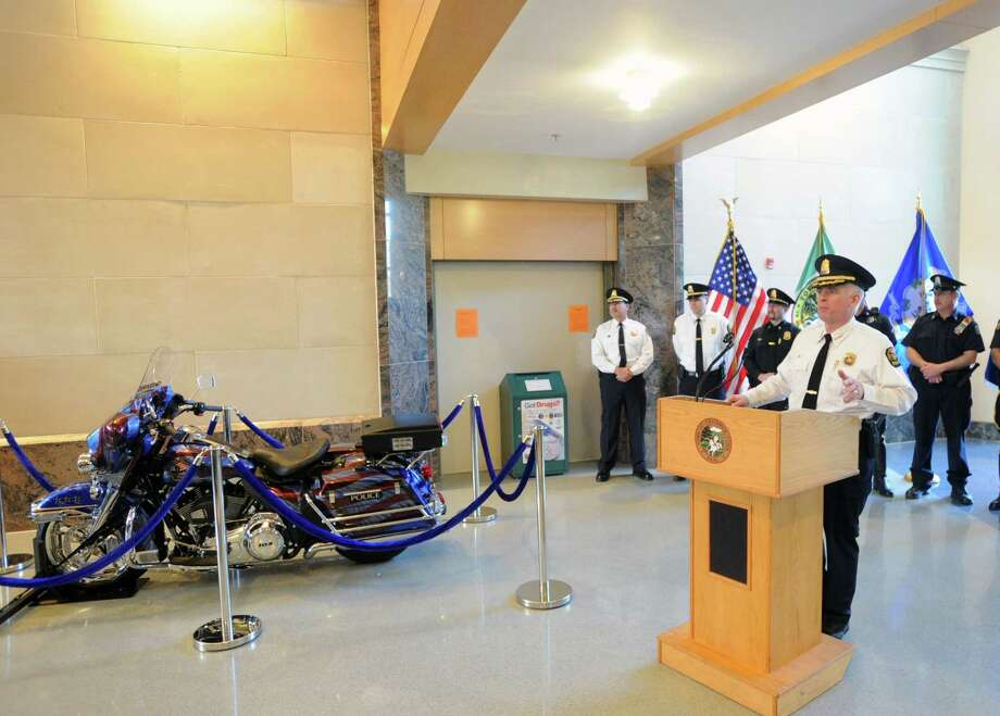 "At right, Greenwich Police Chief James Heavey, speaks during the Greenwich Police Department's unveiling of their, ""Tribute to Heroes"" motorcycle at Greenwich Police Headquarters in Greenwich, Conn., Saturday morning, March 15, 2014. According to Greenwich Police Sgt. John Slusarz, the Tribute motorcycle project was the collaboration of many officers within the department and  honors the heroes of the 911 terrorist attacks and the three Greenwich Police Officers who lost their lives in the line of duty. Photo: Bob Luckey / Greenwich Time"