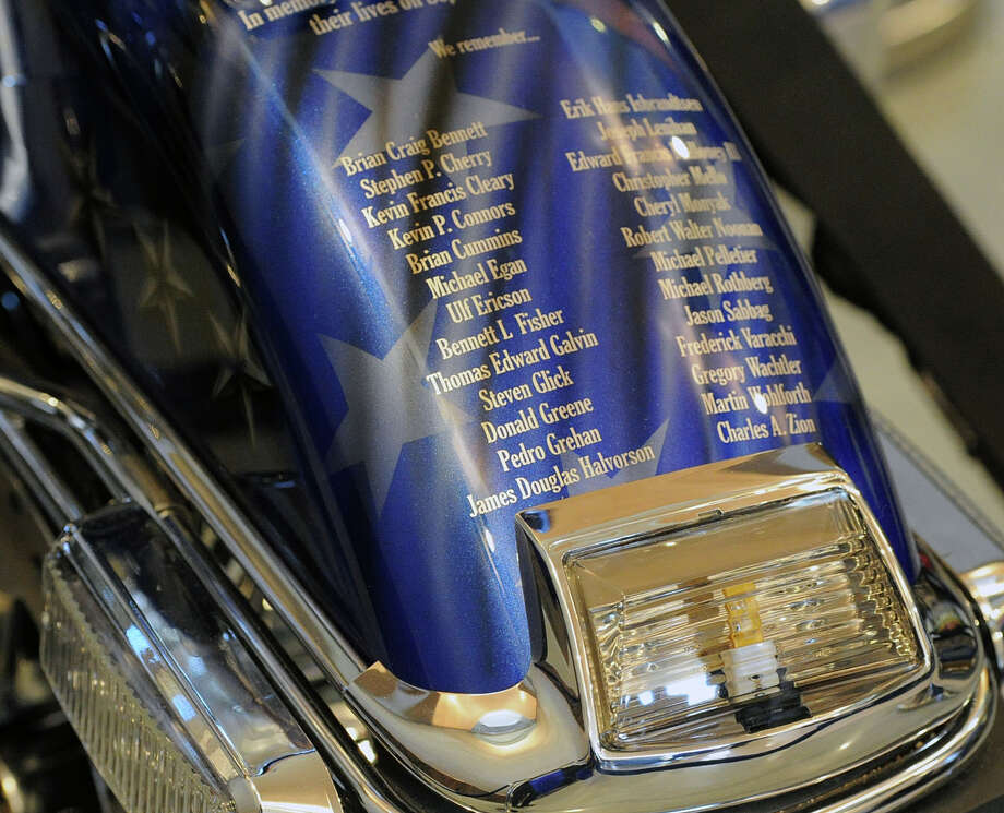 "The Greenwich Police Department unveiling of their, ""Tribute to Heroes"" motorcycle at Greenwich Police Headquarters in Greenwich, Conn., Saturday morning, March 15, 2014. According to Greenwich Police Sgt. John Slusarz, the Tribute motorcycle project was the collaboration of many officers within the department and  honors the heroes of the 911 terrorist attacks and the three Greenwich Police Officers who lost their lives in the line of duty. Photo: Bob Luckey / Greenwich Time"