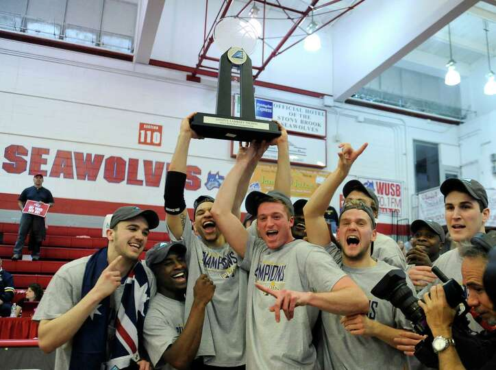 Albany celebrates their 69-60 win over Stony Brook for the championship of the America East Conferen