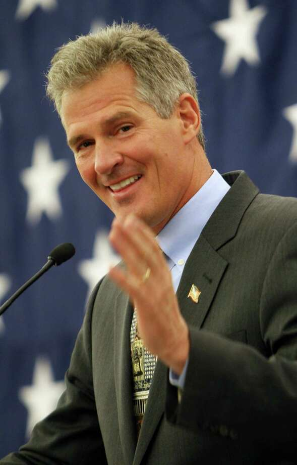 Former Massachusetts Senator Scott Brown acknowledges his wife Gail as he announces his plans to form an exploratory committee to enter New Hampshire's U.S. Senate race against Democratic Sen. Jeanne Shaheen,, Friday, March 14, 2014 in Nashua, N.H. (AP Photo/Jim Cole) ORG XMIT: NHJC108 Photo: Jim Cole / AP