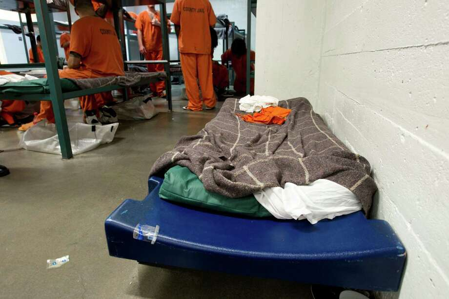 Plastic variance beds at the Harris County Jail  allow for more inmates. The jail population was roughly 8,600 in February, and officials want to boost capacity. Photo: Brett Coomer, Staff / © 2013 Houston Chronicle