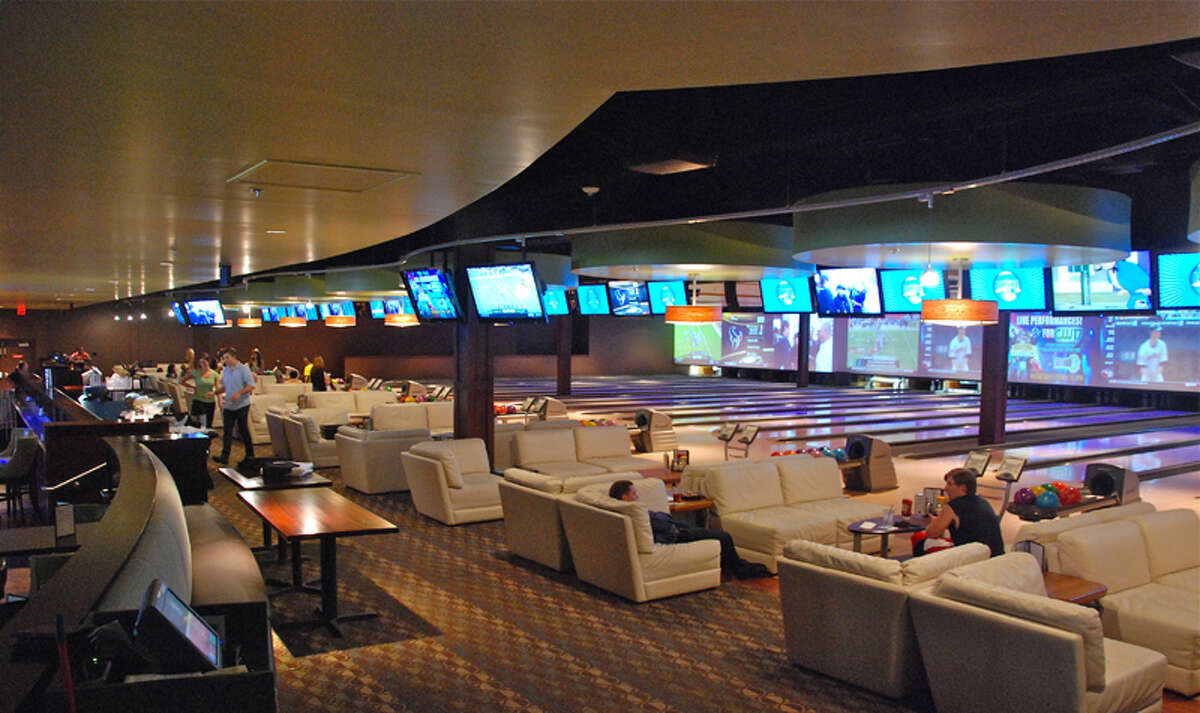Inside a Latitude 360 Bowling establishment. Latitude 360 will include leather couches, large video screens, a sports theater, and arcade and live performers.