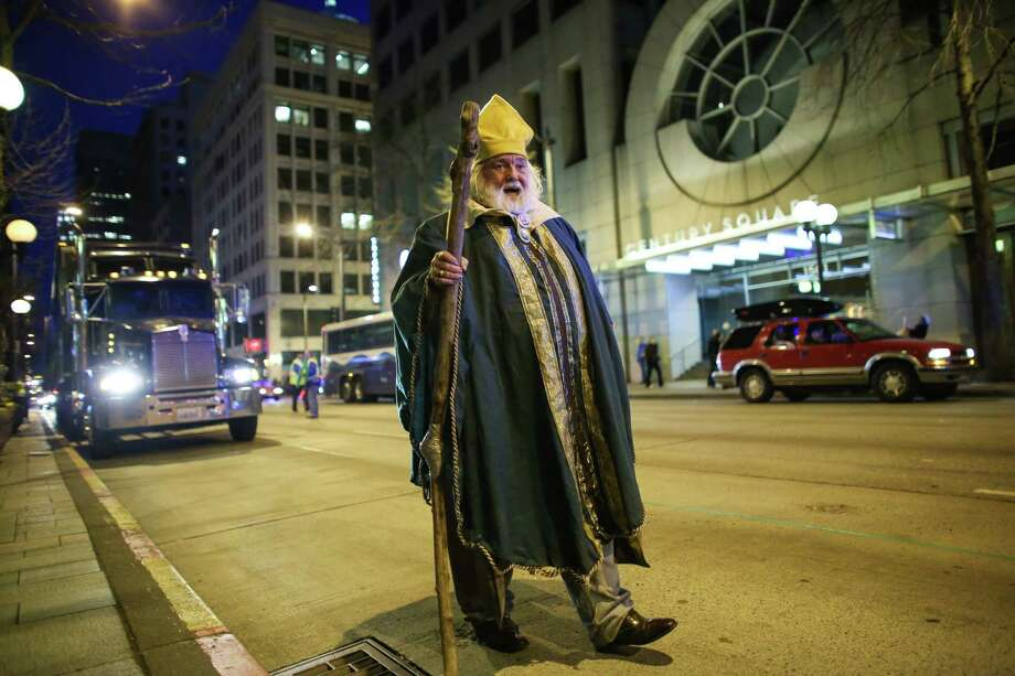 William Patrick Matthew Kiley, dressed as Saint Patrick, walks the route during the 44th annual Laying O' The Green Stripe on 4th Avenue in downtown Seattle. Kiley has played the role of Saint Patrick for 44 years, since the parade in Seattle started. A green stripe is painted along the street to mark the route of the St. Patrick's Day Parade. Photographed on Friday, March, 15, 2014. Photo: JOSHUA TRUJILLO, SEATTLEPI.COM / SEATTLEPI.COM
