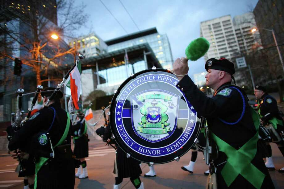 The Seattle Police Department Pipes and Drum Corps plays during the 44th annual Laying O' The Green Stripe on 4th Avenue in downtown Seattle. A green stripe is painted along the street to mark the route of the St. Patrick's Day Parade. Photographed on Friday, March, 15, 2014. Photo: JOSHUA TRUJILLO, SEATTLEPI.COM / SEATTLEPI.COM