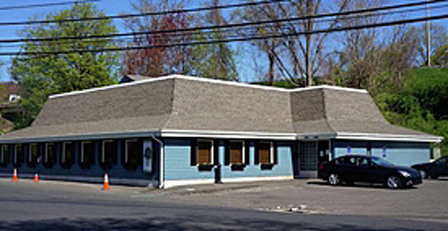 The commercial property at 60 Charles St., which has previously housed restaurants, was recently sold for $2.7 million. Photo: Contributed Photo / Westport News