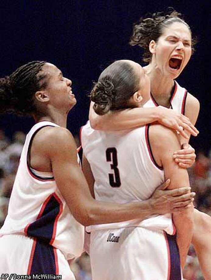 The 2001-2002 UConn is one of the best teams in NCAA  history. Led by Diana Taurasi and Sue Bird, the Huskies trounced  Tennessee in the national semifinal game by 23 points. They followed  that up with an 82-70 win over Oklahoma for the championship. UConn  finished the season a perfect 39-0. (AP Photo/Donna McWilliam) Photo: DONNA MCWILLIAM