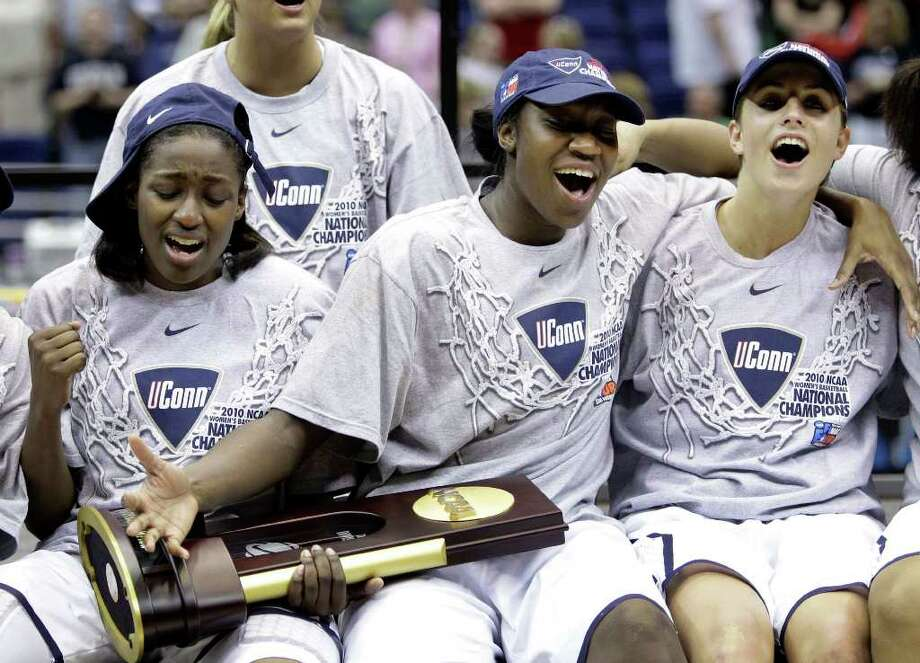 Connecticut's Heather Buck, left, Tina Charles, center and Caroline Doty, right, celebrate with the trophy following the women's NCAA Final Four college basketball championship game against Stanford Tuesday, April 6, 2010, in San Antonio. Connecticut won 53-47. (AP Photo/Eric Gay) Photo: Eric Gay, AP / AP