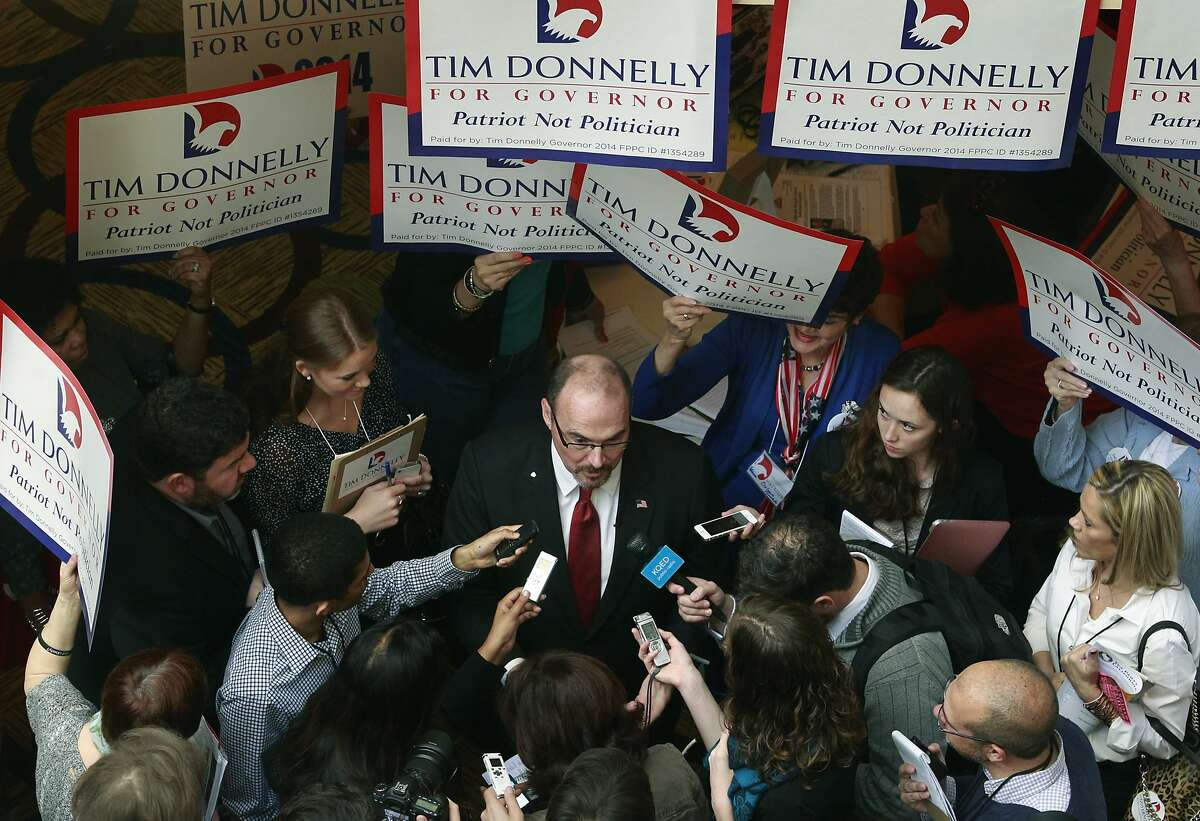 Gubernatorial candidate Tim Donnelly is the center of attention while he meets with reporters at the California Republican Party spring convention in Burlingame, Calif. on Saturday, March 15, 2014.