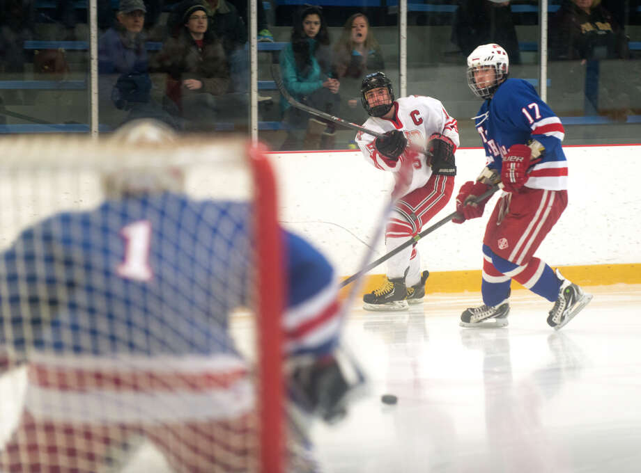 Fairfield Prep's Kenneth Kochiss (15) takes a shot on goal during the boys ice hockey state quarterfinals game against Glastonbury High School at Bennett ice skating rink in West Haven on Saturday, Mar. 15, 2014 Photo: Amy Mortensen / Connecticut Post Freelance
