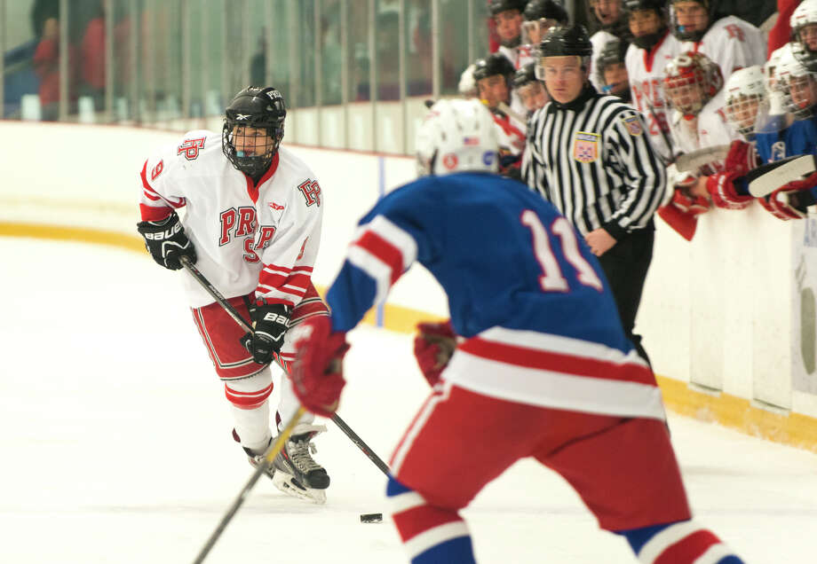 Fairfield Prep's William Overby (9) controls the puck during the boys ice hockey state quarterfinals game against Glastonbury High School at Bennett ice skating rink in West Haven on Saturday, Mar. 15, 2014 Photo: Amy Mortensen / Connecticut Post Freelance