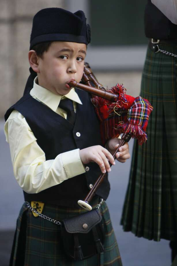 Lars Lund, 5, plays his bagpipe during the St. Patrick's Day Parade on March 15, 2014 in San Francisco, Calif. The 163rd annual parade ran from down a packed 2nd Street and Market to the Civic Center with dozens of floats. Photo: Codi Mills, The Chronicle