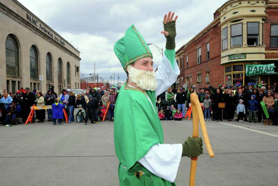 Connor Stark portrays St. Patrick as he marches in the 64th Annual Albany St Patrick's Day Parade on Saturday March 15, 2014 in Albany, N.Y. (Michael P. Farrell/Times Union) Photo: Michael P. Farrell / 00025878A