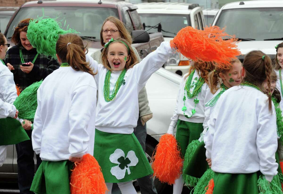 Nine-year-old Jackie Driggs waves her pom-poms as she marches with the Menands St. Patrick Club during the 64th Annual Albany St Patrick's Day Parade on Saturday March 15, 2014 in Albany, N.Y. (Michael P. Farrell/Times Union)