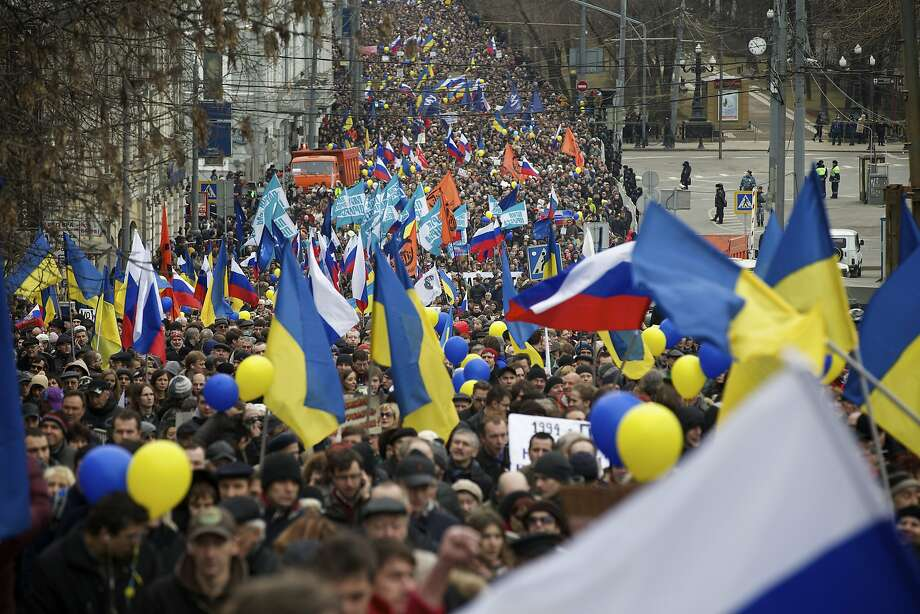 Demonstrators oppose the ballot measure that seeks to have Crimea break away from Ukraine and become part of Russia. Photo: Alexander Zemlianichenko, Associated Press