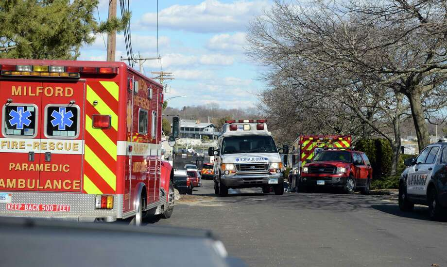 Emergency crews set up a staging area for their rescue of two people from the Long Island Sound Saturday, Mar. 15, 2014, at the Milford Yacht Club on Trumbull Avenue in Milford, Conn. The boaters were taken to Milford Hospital for treatment after they were pulled from the water. Photo: Autumn Driscoll / Connecticut Post