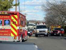 Emergency crews set up a staging area for their rescue of two people from the Long Island Sound Saturday, Mar. 15, 2014, at the Milford Yacht Club on Trumbull Avenue in Milford, Conn. The boaters were taken to Milford Hospital for treatment after they were pulled from the water.