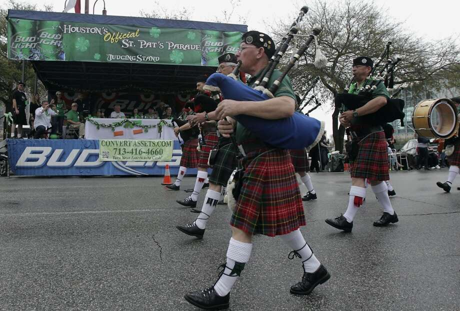Bag pipes being played pass the judging stand during the 55th annual St. Patrick's parade Saturday, March 15, 2014, in Houston. ( James Nielsen / Houston Chronicle ) Photo: Houston Chronicle
