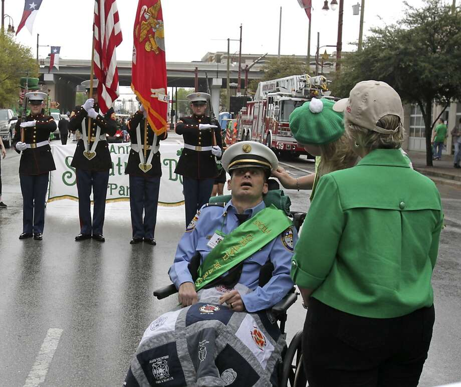 The 55th annual St. Patrick's parade Grand Marshall Houston Fire Captain William Dowling and his wife Jacki Dowling center, speak with Houston Mayor Annise Parker before the start of the parade Saturday, March 15, 2014, in Houston.