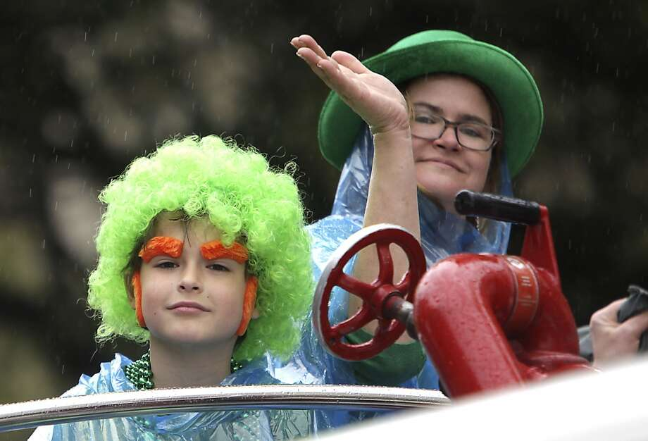 People waves while riding on a fire truck during the 55th annual St. Patrick's parade which salutes Houston's first responders this year Saturday, March 15, 2014, in Houston. ( James Nielsen / Houston Chronicle ) Photo: Houston Chronicle