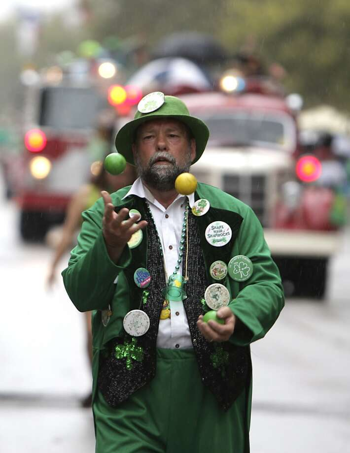 A juggler performs during the 55th annual St. Patrick's parade which salutes Houston's first responders this year Saturday, March 15, 2014, in Houston. ( James Nielsen / Houston Chronicle ) Photo: Houston Chronicle