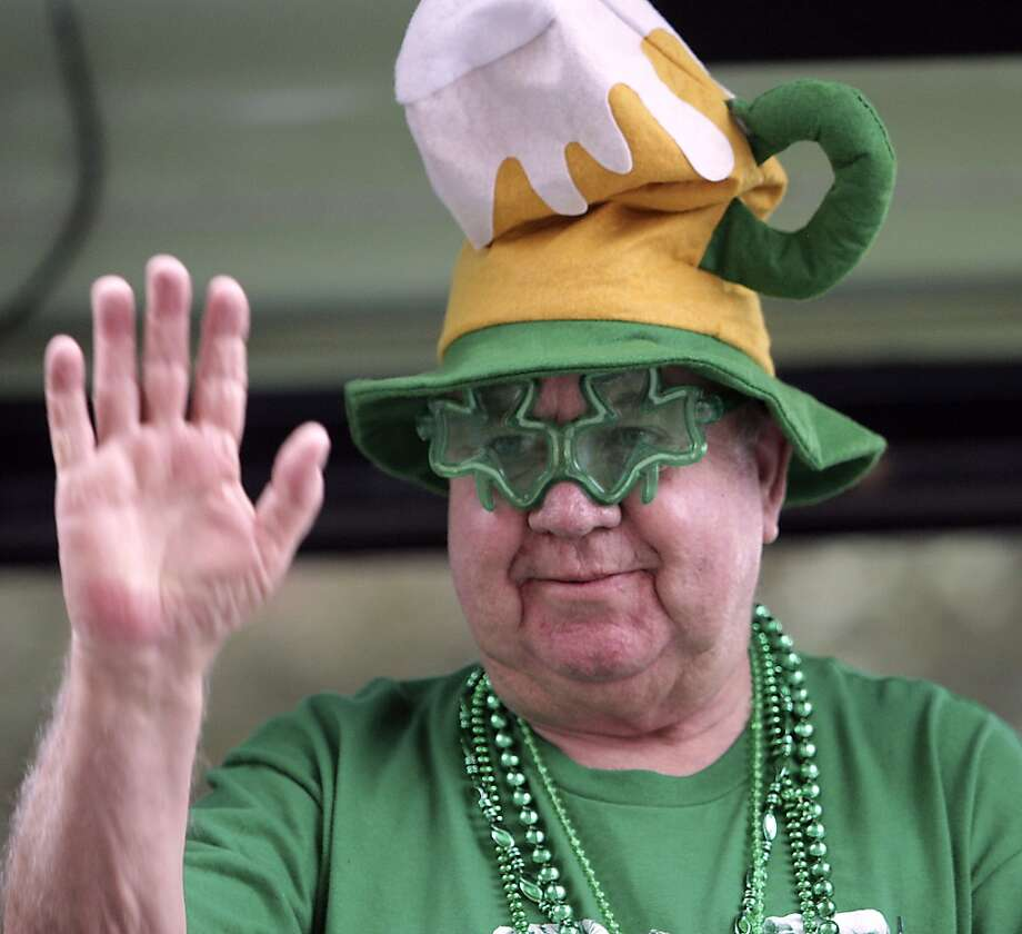 A man on a float waves on during the 55th annual St. Patrick's parade which salutes Houston's first responders this year Saturday, March 15, 2014, in Houston. ( James Nielsen / Houston Chronicle ) Photo: Houston Chronicle