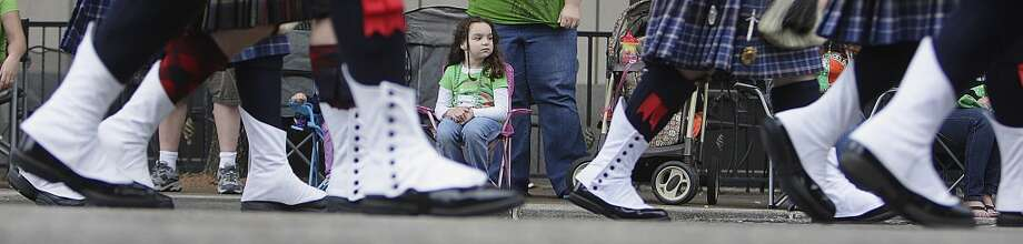 Five-year-old Allie Hylan center, looks on during the 55th annual St. Patrick's parade which salutes Houston's first responders this year Saturday, March 15, 2014, in Houston. ( James Nielsen / Houston Chronicle ) Photo: Houston Chronicle
