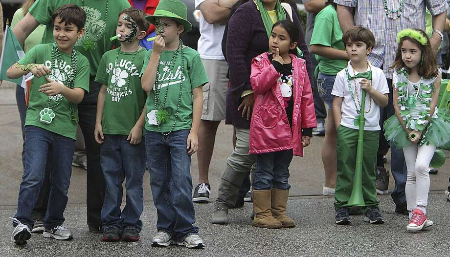 Children look on during the 55th annual St. Patrick's parade which salutes Houston's first responders this year Saturday, March 15, 2014, in Houston. ( James Nielsen / Houston Chronicle ) Photo: Houston Chronicle