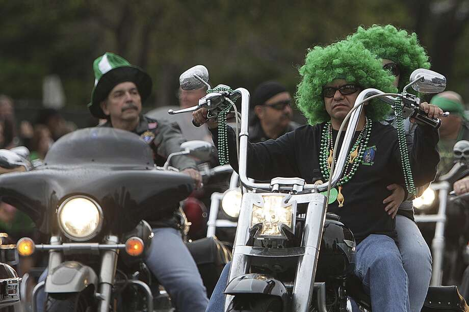 A group of motorcycles in the 55th annual St. Patrick's parade which salutes Houston's first responders this year Saturday, March 15, 2014, in Houston. ( James Nielsen / Houston Chronicle ) Photo: Houston Chronicle