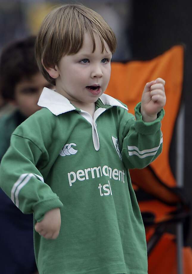 Padriaig Dolan plays air drums during the 55th annual St. Patrick's parade Saturday, March 15, 2014, in Houston. ( James Nielsen / Houston Chronicle ) Photo: Houston Chronicle