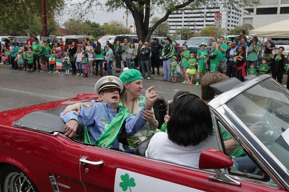 The 55th annual St. Patrick's parade Grand Marshall Houston Fire Captain William Dowling and his wife Jacki Dowling during the parade Saturday, March 15, 2014, in Houston. ( James Nielsen / Houston Chronicle ) Photo: Houston Chronicle