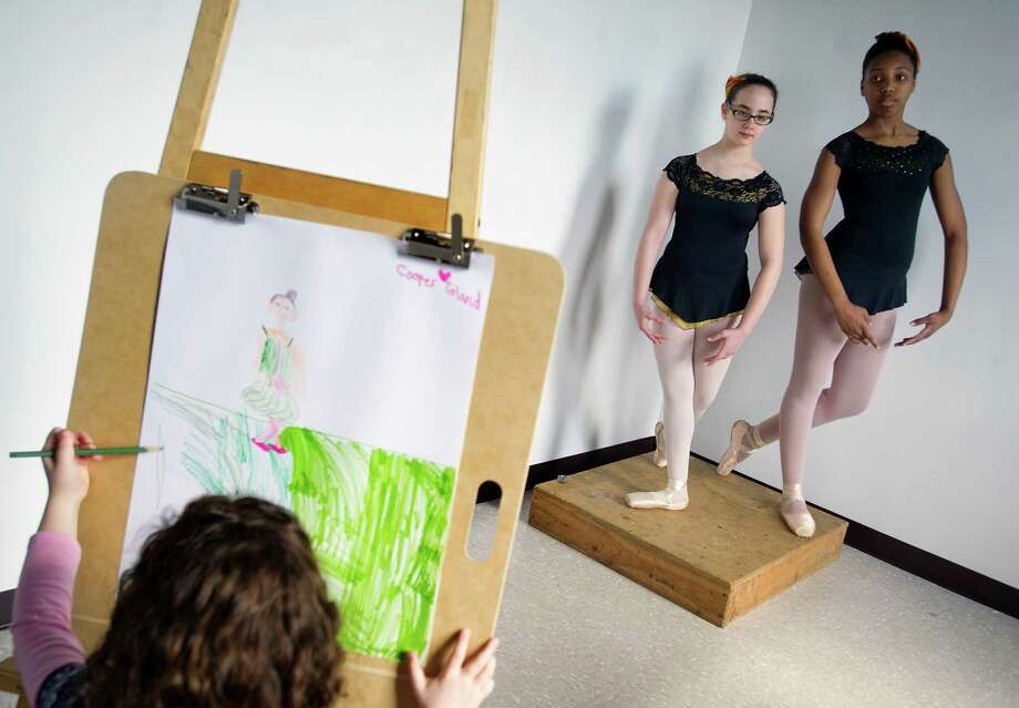Cooper Toland, 6, draws ballerinas Taylor Richards, 13, far right, and Franki Mastrone, 11, center, during the Loft Artists Association's free Draw On workshop on Saturday, March 15, 2014. Photo: Lindsay Perry / Stamford Advocate