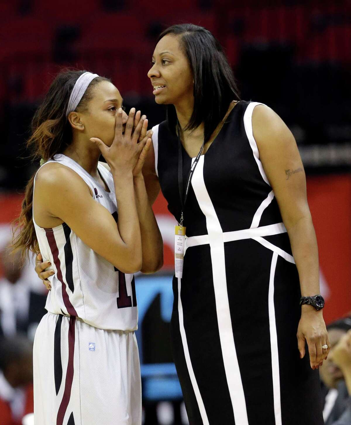 Texas Southern's Morgan Simmons, left, talks with her coach Johnetta Hayes-Perry after being called for technical foul during the closings minutes of the second half of an NCAA college basketball game against Prairie View A&M in the championship of the Southwestern Athletic Conference tournament Saturday, March 15, 2014, in Houston. Prairie View A&M won 63-58. (AP Photo/David J. Phillip)