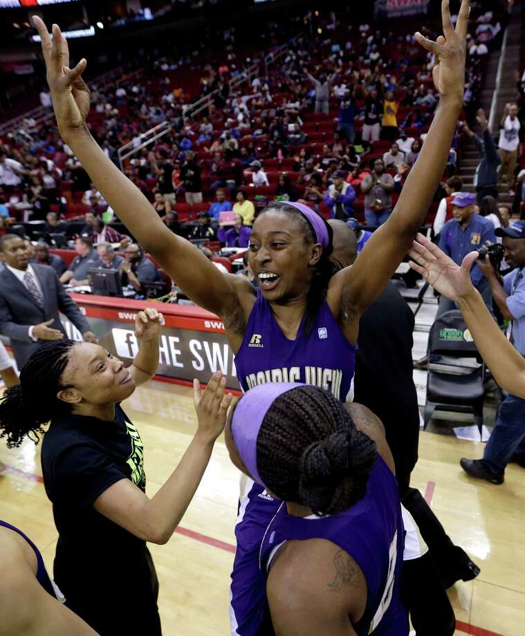 Prairie View A&M's LaReahn Washington, rear, celebrates as she is lifted up by Shamiya Brooks after their team beat Texas Southern 63-58 in an NCAA college basketball game in the championship of the Southwestern Athletic Conference tournament Saturday, March 15, 2014, in Houston.  (AP Photo/David J. Phillip) Photo: David J. Phillip, Associated Press / AP