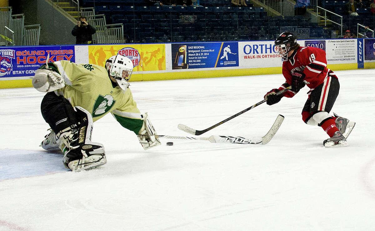 New Canaan's Henry Stanton gets by Notre Dame-West Haven's goalie but misses the shot during Saturday's Division I semifinal game at Webster Bank Arena in Bridgeport, Conn., on March 15, 2014.