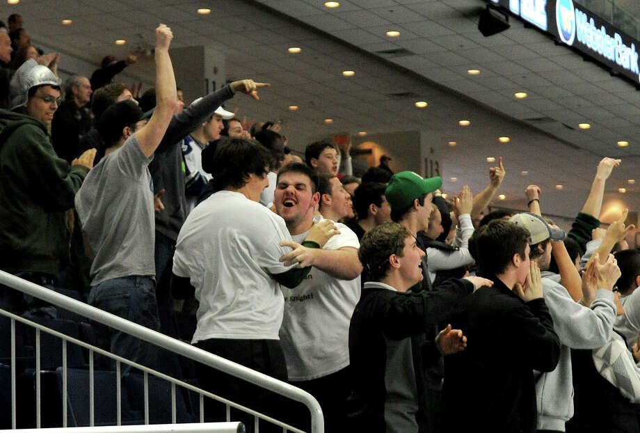 Notre Dame-West Haven fans cheer after their team scored the game's first goal in the last minutes of the third period of Saturday's Division I semifinal game against New Canaan at Webster Bank Arena in Bridgeport, Conn., on March 15, 2014. Photo: Lindsay Perry / Stamford Advocate